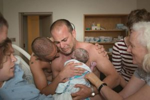 This photo by Lindsay Foster shows new dads Frank Nelson, 44, and BJ Barone, 34, hold their son Milo for the very first time on June 27, 2014 in Kingston, Ontario. This family was not part of our study but I can't help but share this beautiful photo. Click here for more about their story.